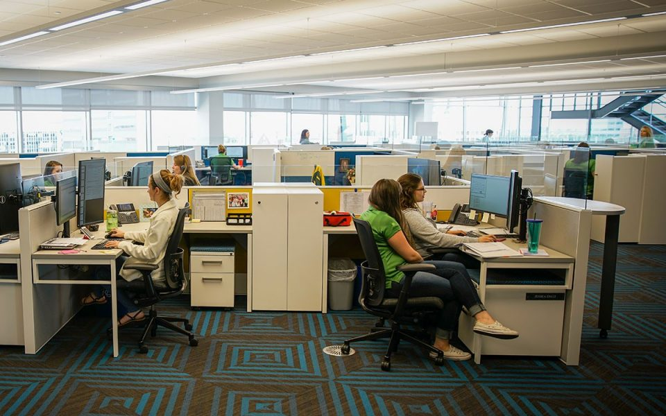 Ash Team Works Inside Brand New Office