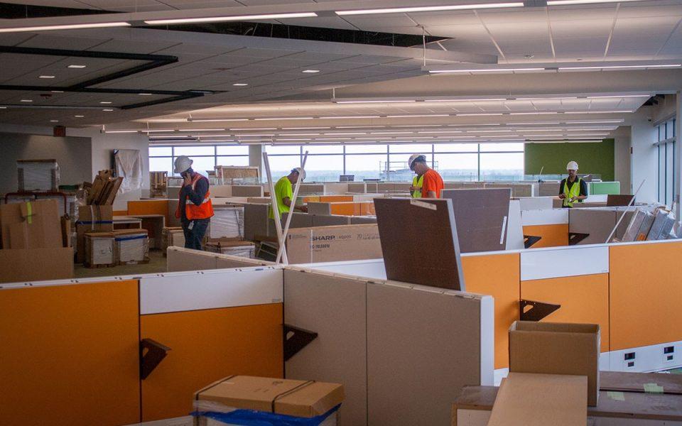 Workers Assemble Desks in Ash Brokerage Building