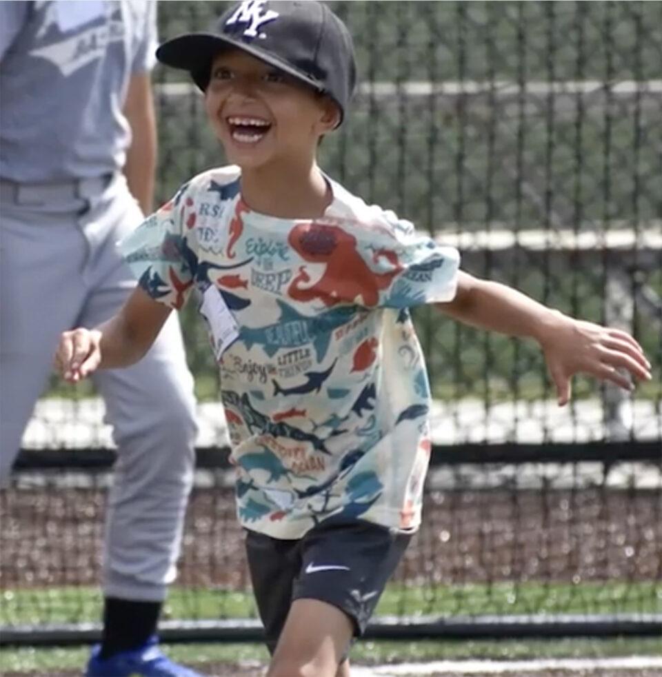 Child Smiles at World Baseball Academy Fort Wayne
