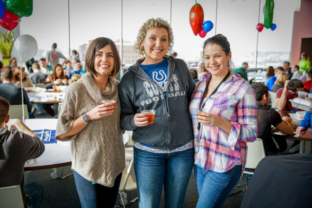 Ash Brokerage Employees Smile At Team Lunch