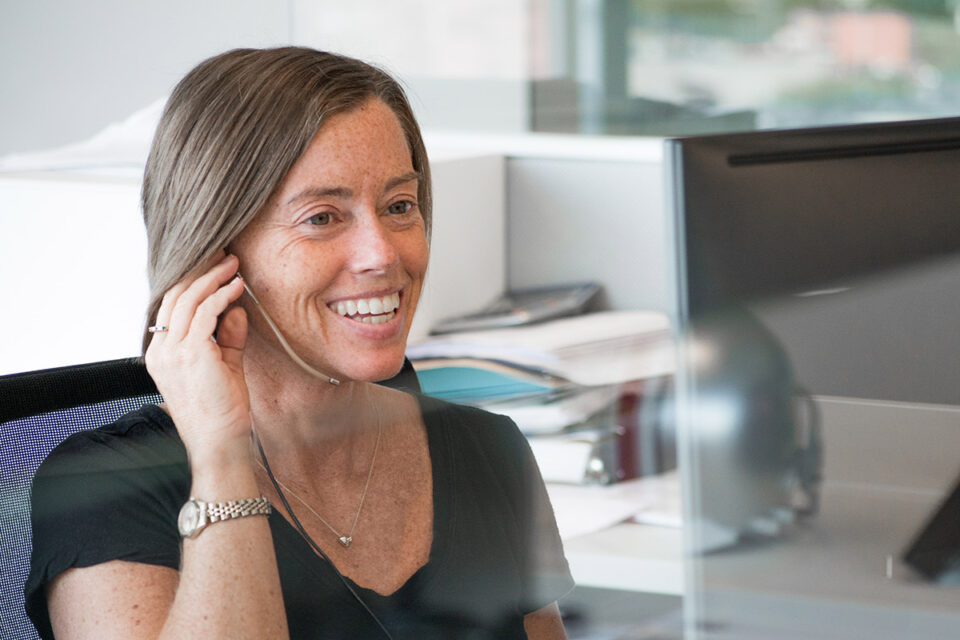 Megen Gaylord Answers Phone Call at Ash Brokerage